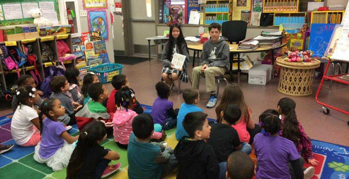 Young children reading to second graders
